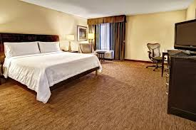 a bed or beds in a room at hilton garden inn nashville airport