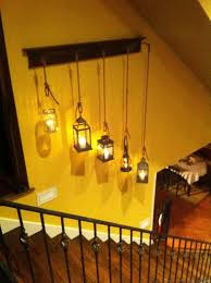 hang several vintage lanterns or mason jar lamps to fill your plain wall