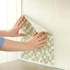 installing glass tile backsplash photo 6 of 7 install tile press glass tile into the kitchen