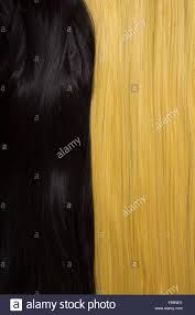 texture of black and golden blond hair soft focus stock image