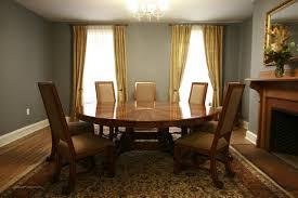 large oversized round dining table mahogany room
