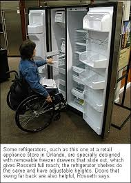 Woman In Wheelchair Checking Out A Fridge