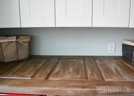 make a laundry room countertop from an old door the diy mommy intended for above washer