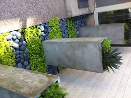 make a fantastic first impression with creative plantings that frame your front door this modern home in ogden boasts a graphic pairing of black river rock