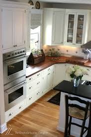 Light Floor White Cabinets Dark Wood Countertops Custom American