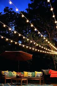 hanging lights in backyard a canopy of string lights in our backyard hanging outdoor lights with