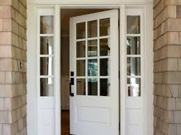 a front door to a house with panes of glass installed by santa fe glass in