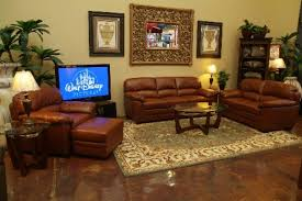 cream wall with mirror also pictures combined with brown leather sofa feat oval glass top table