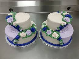 Twin 2 Tier Wedding Cakes With Buttercream Icing In A Lavender Ivory