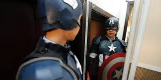 captain america cosplayer looking in mirror