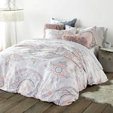 with its whimsical flair and soft muted tones the painted medallion duvet cover sham set captures dreamy bohemian style a crisp white ground sets medallion duvet cover d55