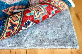 area rugs pad why use rug pad on your area rugs for refined throughout designs