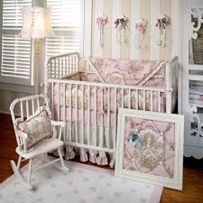mini rocking chair beside classic cradles with blossom bedding motif illuminated with floor lamp sweet cherry
