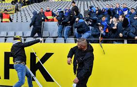 Dortmund and Schalke fans clash with police and hit with batons during  fierce Bundesliga derby