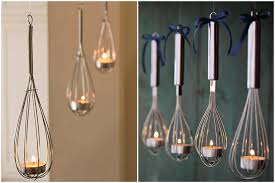 Another candle holder idea that you can make on your own is the one that  made with whisk. To hang the whisks and light a candle inside each whisk is  so ...
