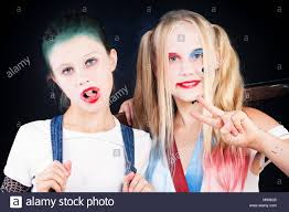 young s with makeup portrait of two children with artistic make up