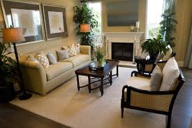 Wicker Sided Black Armchairs Are Matched With The Lipped Dark Coffee Table  And Black Fireplace