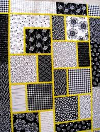 12 large blocks (18  each) with only 5 pieces to each block ... & Big Block w/ yellow or aqua, or fuchsia., pattern by Black Cat. LOVE the  black and white with the bright color popping in between. Adamdwight.com