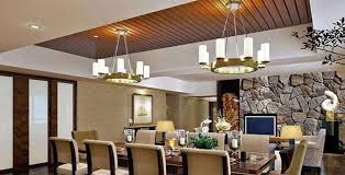 Wooden ceiling and stone wallpaper for design of dining room