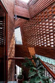 Perforated Brick Wall Design H P Architects Wraps Perforated Brick Walls Around Brick