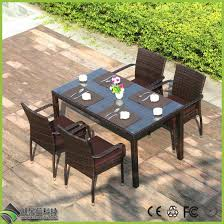 china rattan glass top table and chairs