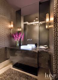 powder room lighting home design photos. lighting is a main focus of this powder room where luminist vessel glows with its led ring sconces from lbl filter light through smokecolored home design photos e