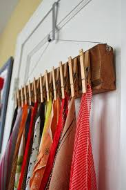 scarves could be hanged on a diy wood plank with clothspins