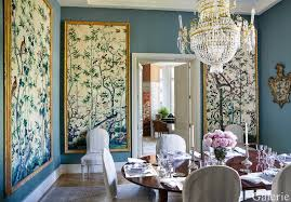 An Antique Chandelier Hangs Above A Louis XVI Mahogany Dining Table And  Chairs, Which Are Slipcovered In A Striped Cotton, And The Walls Are Clad  In A ...
