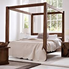 welcoming and cozy four poster bed canopy  modern wall sconces