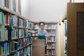 essay assignment descriptive and informative profile young female n arranging books in a library
