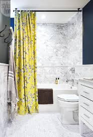 blue and yellow shower curtain. white and blue bathroom with yellow shower curtain