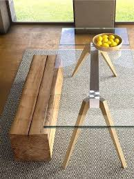 modern wood and glass dining table a table with a metal frame and wooden legs a