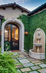 LOVE THIS solid green on the side wall with the fountain and the iron entry  door