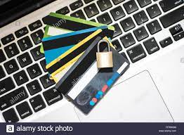 internet security concept, with credit card atm and padlock on laptop  keyboard, online security transaction Stock Photo - Alamy