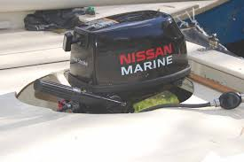 today my new nissan 4 stroke outboard arrived and to my relief i found that it fit perfectly into the motor mount built into the tiki 21 bridgedeck by the
