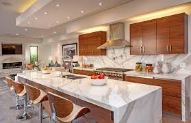 contemporary kitchen with eat in dining island and marbled back splash