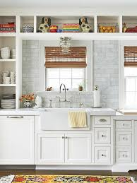 white kitchen with open shelves farmhouse sink marble countertoparble subway tile backsplash