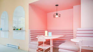 cafe with arched mirrors pink benches and tables