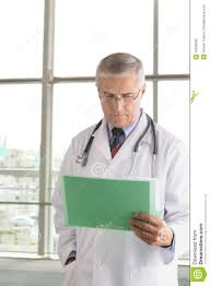 Doctor Reading Chart Middle Aged Doctor Reading Chart Stock Photo Image Of