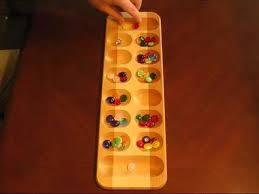 Game With Rocks And Wooden Board Delectable Mancala The African Stone Game YouTube