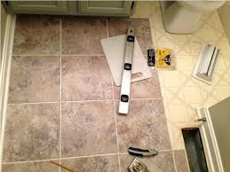 how to install vinyl tile flooring on kitchen floor tiles self marble family dollar adhesive