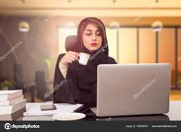 zara woman combined office. Arab Young Business Woman Sitting At Her Desk In An Office, Working On A Laptop Computer And Drinking Coffee Or Tea. \u2014 Photo By Mr.zara Zara Combined Office