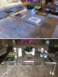 a large 1700mmm x 1700mm bespoke coffee table with highly polised 25mm clear perspex top and 100mm square legs