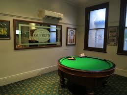 a round pool table at the freemason hotel