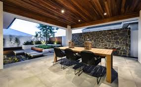 recessed outdoor lighting with modern furniture design for stylish patio ideas using natural stone wall
