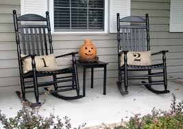 black painted pine wood rocking chairs which mixed with small coffee table front porch rocking