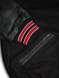 black varsity letterman jacket with red white stripes
