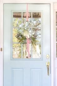 how to hang wreaths on windows with ribbon