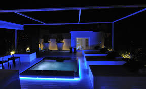 Blue Lit Residence With Black And White Flair
