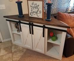 25 trending tv stands ideas on tv stand designs diy corner tv console with sliding barn doors all ready for delivery